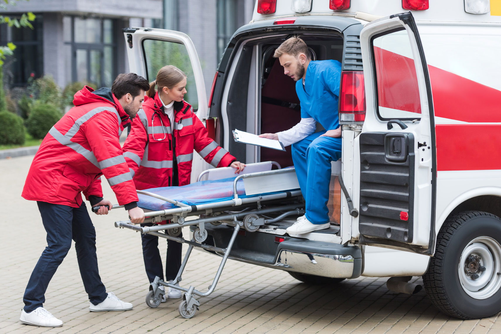 Paramedics Unloading a Stretcher From an Ambulance | Medical Equipment Services in Houston, TX
