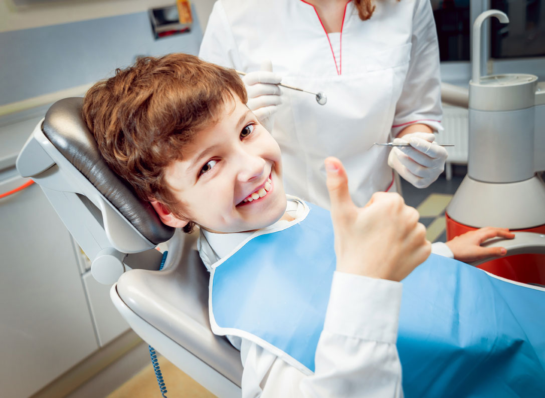 A Little Boy Smiling in the Dental Clinic | Dental Clinics are Covered by Our Medical Equipment Services in Houston, TX
